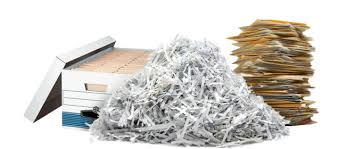What do shredding companies do with the paper?